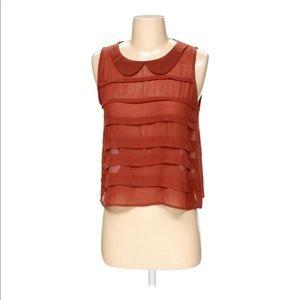 Lush rust sleeveless blouse